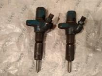 Doua injectoare tractor 445