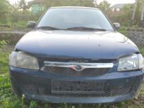 Dezmembrez Mazda 323F kombi 2.0 diesel, an 1999