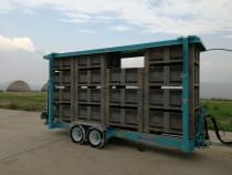 Remorca autodescarcatoare pentru transportat boxpaleti