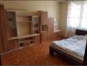 O camera in apartament decomandat cu 2 camere garii