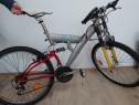 Bicicleta cu suspensie