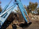 Brat excavat tractor