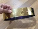 Curea metalică pentru marcarea taliei